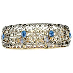 12 Carat Sapphire, 7 Carat Diamond, Silver and Gold Bangle Bracelet