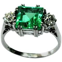 Emerald White Diamond Platinum Three-Stone Engagement Ring