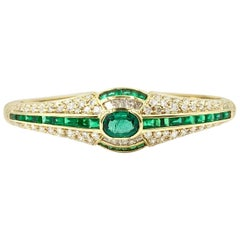 Emerald and Approximate 3.50 Carat Diamond 18 Karat Yellow Gold Bangle Bracelet