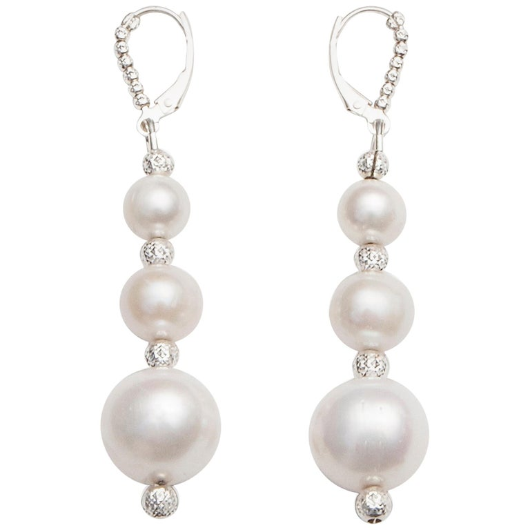 White Pearl Drop Earrings in a Three-Tiered Design