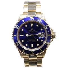 Rolex Submariner 18 Karat Yellow Gold 16808 Blue Dial Blue Bezel