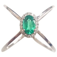 Ladies 14 Karat White Gold Oval Emerald and Round Diamond Ring