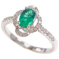 Ladies 14 Karat White Gold Oval Emerald and Round Diamond Ring