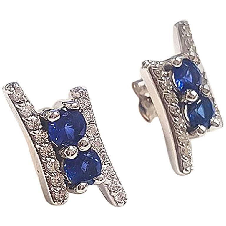 Ladies 14 Karat White Gold Round Sapphire and Round Diamond Earring