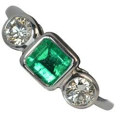 Platinum Columbian Emerald and 0.50 Carat VS Diamond Trilogy Engagement Ring