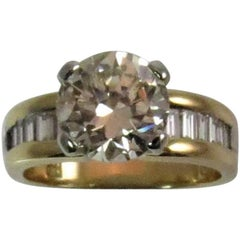 18K Yellow and White Gold Ring Set with 2.11ct  Round Diamond and Baguettes