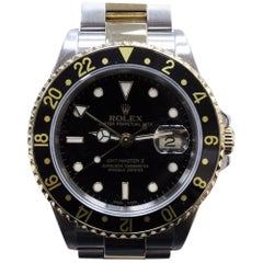 Rolex GMT Master II 16713 Black 18 Karat Gold and Steel Box and Booklets 2004