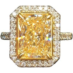 GIA Certified 4.02 Carat UV Color Yellow Diamond Halo Ring