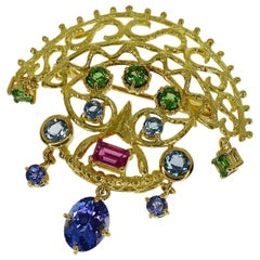 Tasaki Color Stone Pendant Brooch 18 Karat Yellow Gold Tanzanite 1.55 Carat