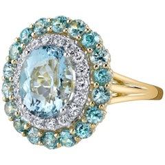 3.37 Oval Aquamarine, Blue Zircon, and White Diamond 18 Karat Yellow Gold Ring