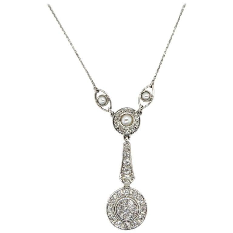 1920s Seed Pearl and 0.95 Carat Diamond Pendant