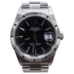 Rolex Date 15210 Stainless Steel Engine Turned Bezel Black Dial