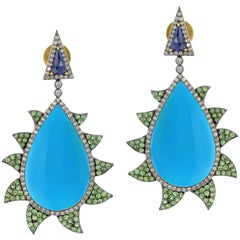 Meghna Jewels Claw Earrings Turquoise Tsavorite Blue Sapphire and Diamonds