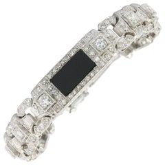 Art Deco Platinum Diamond Onyx Conversion Bracelet, circa 1930s
