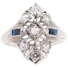 1930s Art Deco 0.25 Carat Diamond and Sapphire Platinum Engagement Ring