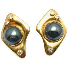 Round Diamond and Cabochon Hematite Free-Form Yellow Gold Clip Earrings