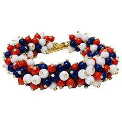 18 Karat Yellow Gold Red, White and Blue Bracelet, Ring and Earring Suite