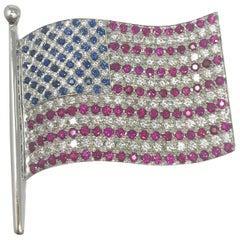 18 Karat White Gold, 2.04 Ct Diamond, .55 Ct Sapphire, 3.15 Ct Ruby Flag Brooch