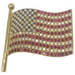 18 K Yellow Gold, 2.04 Ct Diamond, .55 Ct Sapphire, 3.15 Ct Ruby Flag Brooch