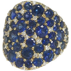 Carelle 18K YG, 6.18 Ct Blue Sapphire, .57 Ct Diamond Tapered Cigar Band Ring