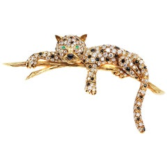 Rare Van Cleef & Arpels Diamond Emerald Onyx Gold Jaguar Brooch
