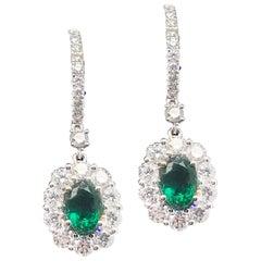 1.40 Carat Oval Cut Emerald and 1.88 Carat Diamond Earrings Set in 18 Karat Gold