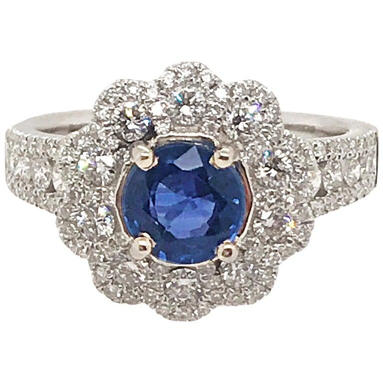 1.10 Carat Round Sapphire Ring with .95 Diamonds Set in 18 Karat White Gold
