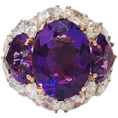 Amethyst Three-Stone Ring with Diamond Halo