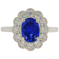 1.51 Carat Oval Sapphire and Diamond Ring with Milgrain Detail