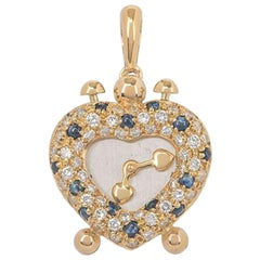 Diamond and Sapphire Heart Clock Pendant