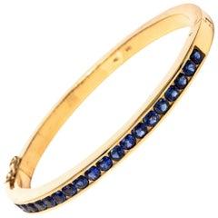 1970s 18 Karat Gold 4.00 Carat Sapphire Bangle Bracelet