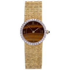Piaget yellow Gold Tiger's Eye Dial Diamond Bezel Wristwatch