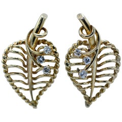 Cartier, 18 Karat Gold and Diamond Leaf Twist Back Earrings