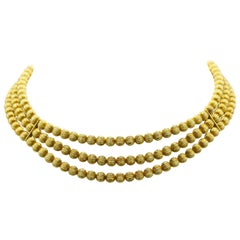lles Lalaounis, Triple Strand Gold Bead Necklace