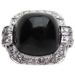 Art Deco 14.9 Carat Sugarloaf Onyx Cabochon and Diamond Platinum Ring