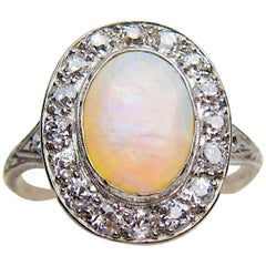 Art Deco 1.40 Carat Cabochon-Cut Opal and Diamond Halo Platinum Ring