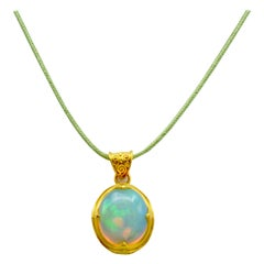 Ethiopian Opal and 22 Karat Gold Pendant