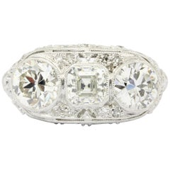 Art Deco Platinum 3-Stone Diamond Engagement Ring, circa 1930s