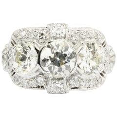 Art Deco Platinum Old European Cut 3-Stone Diamond Engagement Ring, circa 1920s