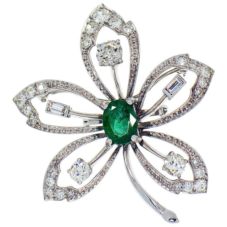 Platinum Flower Brooch, 2.10 Carat Emerald, 1.75 Carat Diamond