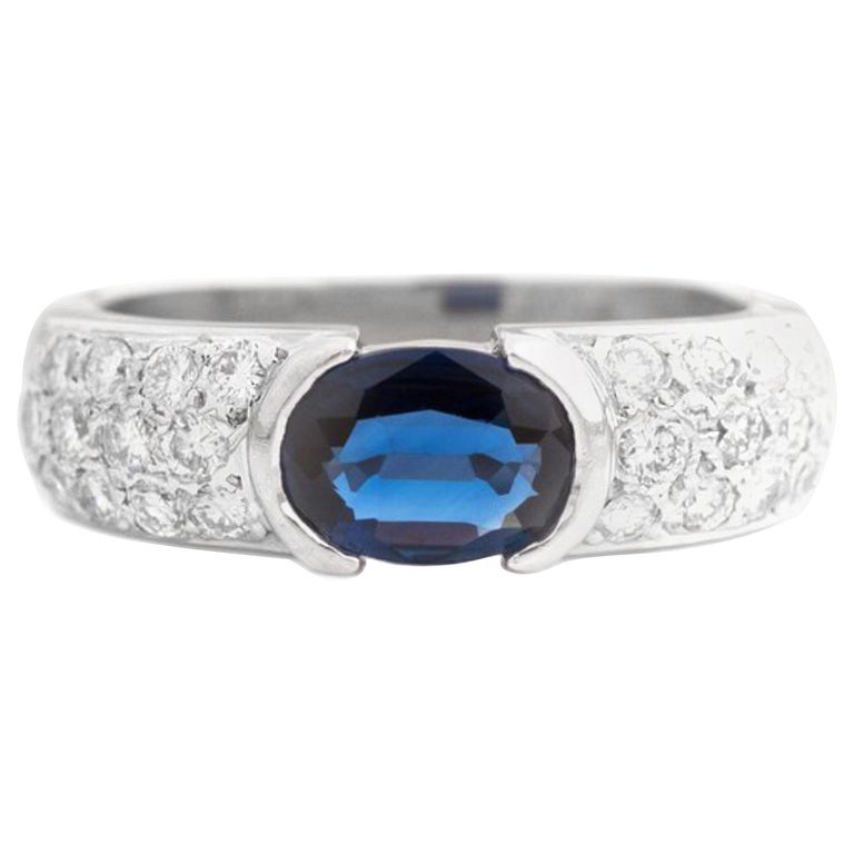 1980s 1 Carat Blue Sapphire and Diamond Platinum Ring