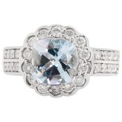 1950s 2 Carat Aquamarine and 2 Carat Diamond Halo, 14 Karat Gold Ring