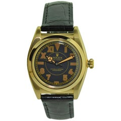 Rolex 14 Karat Gold Art Deco Bubble Back Wristwatch with Legendary Romabic Dial