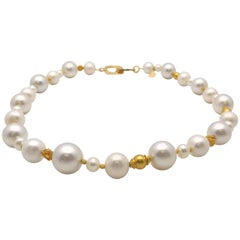 Strand of South Sea and Fresh Water Cultured Pearls with Gold Beads