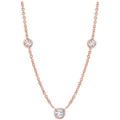 Rose Gold Three-Diamond Weighing 0.55 Carat Bezel Set Pendant Necklace