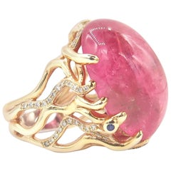 27.78 Carat Cabochon Pink Rubelite Gold Ring with Diamond and Blue Sapphire