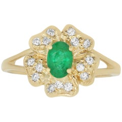 0.47 Carat Oval Emerald and 0.15 Carat White Diamond Ring