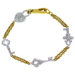 Diamond Heart and Key Designer Bracelet in 18 Karat Yellow and White Gold