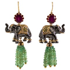 35.0 Carat Emerald 6.20 Carat Ruby Diamond Yellow Gold Elephant Stud Earrings