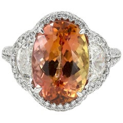 Vibrant Imperial Topaz Ring with Half Moon Cut and Round Diamonds in Platinum